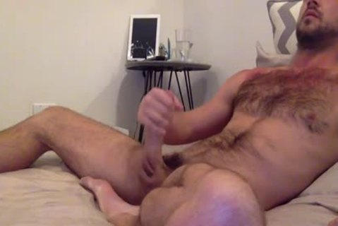 brunette hairy fellow Strokes His large cock'