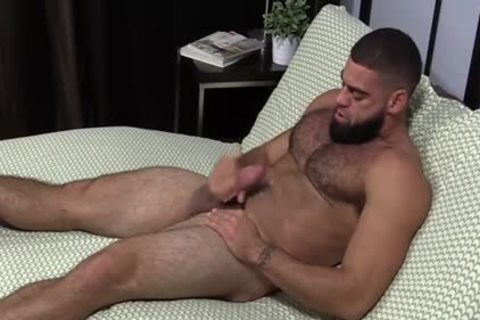 brawny Ricky Larkin stroking Off while Toes Are Sucked
