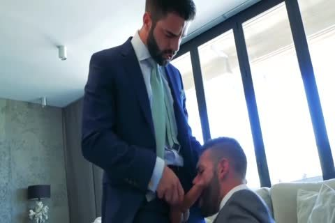 Two males In Suits pound